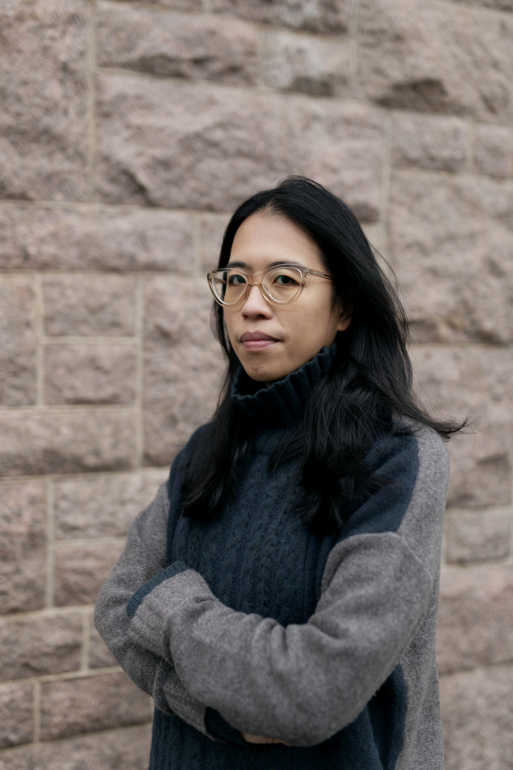 Portrait of Christina Li. She is subtly smiling to the camera.