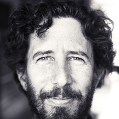 Portrait of Jose Roca, smiling to camera.