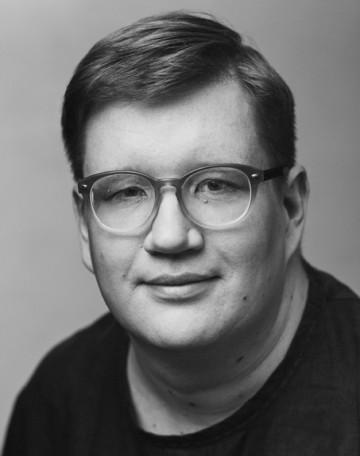 Black and white portrait of Jussi Koitela.