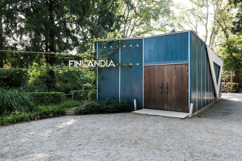 Blue, wooden pavilion by Alvar Aalto is situated in the Giardini Garden