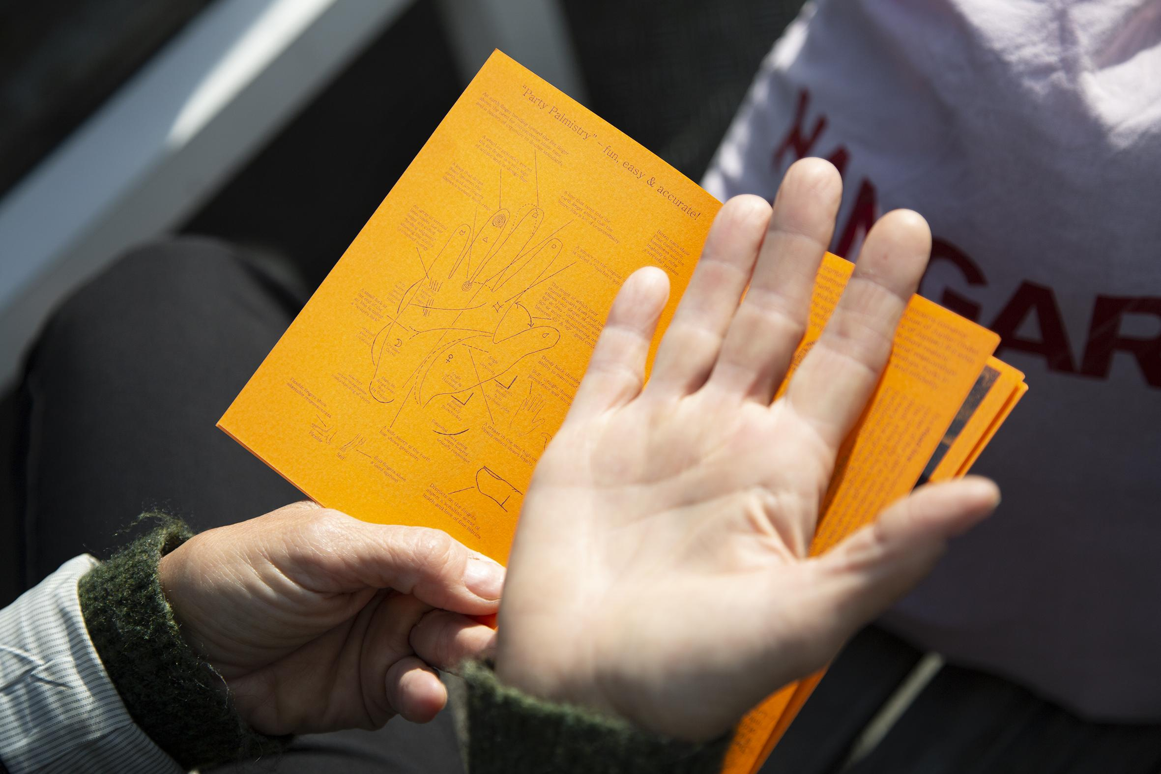 A hand and a leaflet.